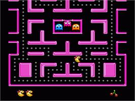 In game image of Ms. Pac-Man on the Nintendo SNES.