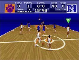 In game image of NCAA Basketball on the Nintendo SNES.