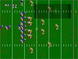 In game image of NCAA Football on the Nintendo SNES.