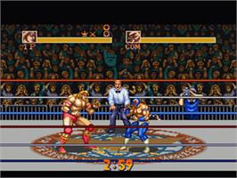 In game image of Saturday Night Slam Masters on the Nintendo SNES.