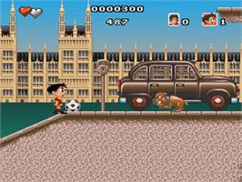 In game image of Soccer Kid on the Nintendo SNES.