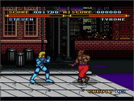 In game image of Street Combat on the Nintendo SNES.