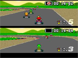 In game image of Super Mario Kart on the Nintendo SNES.