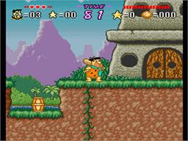 In game image of The Flintstones: The Treasure of Sierra Madrock on the Nintendo SNES.