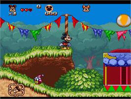 In game image of The Great Circus Mystery starring Mickey and Minnie Mouse on the Nintendo SNES.