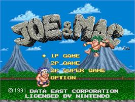 Title screen of Joe & Mac: Caveman Ninja on the Nintendo SNES.