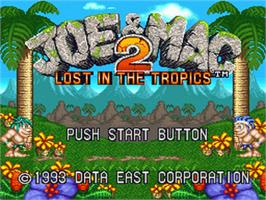 Title screen of Joe & Mac 2: Lost in the Tropics on the Nintendo SNES.