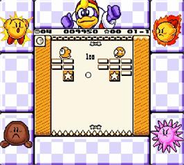 In game image of Kirby's Block Ball on the Nintendo Super Gameboy.