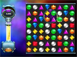 In game image of Bejeweled Twist on the PopCap.