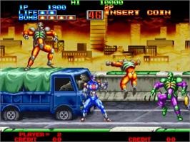 In game image of Eight Man on the SNK Neo-Geo MVS.
