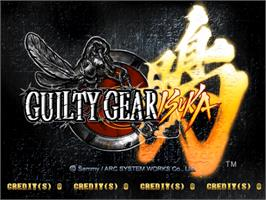 Title screen of Guilty Gear Isuka on the Sammy Atomiswave.