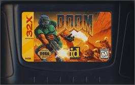 Cartridge artwork for Doom on the Sega 32X.