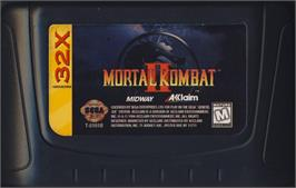 Cartridge artwork for Mortal Kombat II on the Sega 32X.