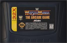 Cartridge artwork for WWF Wrestlemania on the Sega 32X.
