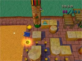In game image of Ms. Pac-Man Maze Madness on the Sega Dreamcast.