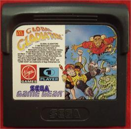 Cartridge artwork for Mick & Mack as the Global Gladiators on the Sega Game Gear.