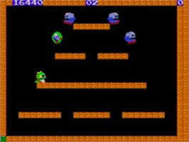 In game image of Bubble Bobble on the Sega Game Gear.