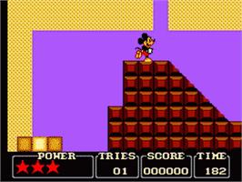 In game image of Castle of Illusion starring Mickey Mouse on the Sega Game Gear.