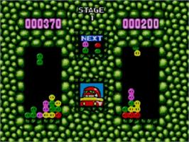 In game image of Dr. Robotnik's Mean Bean Machine on the Sega Game Gear.