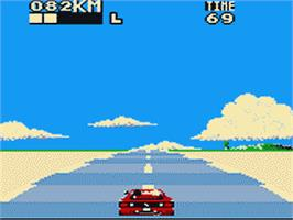 In game image of Out Run on the Sega Game Gear.