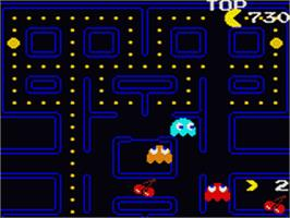 In game image of Pac-Man on the Sega Game Gear.