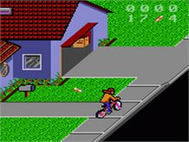 In game image of Paperboy 2 on the Sega Game Gear.