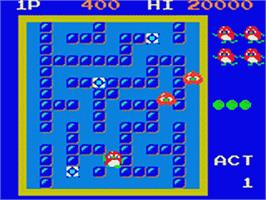 In game image of Pengo on the Sega Game Gear.