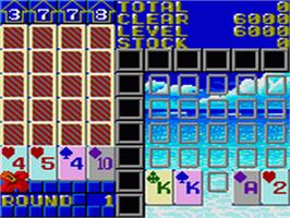 In game image of Solitaire Poker on the Sega Game Gear.