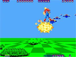 In game image of Space Harrier on the Sega Game Gear.
