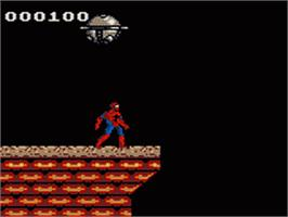 In game image of Spider-Man and the X-Men: Arcade's Revenge on the Sega Game Gear.