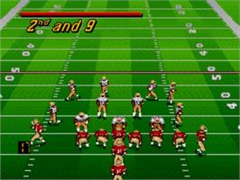 In game image of Bill Walsh College Football 95 on the Sega Genesis.