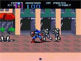 In game image of Captain America and The Avengers on the Sega Genesis.