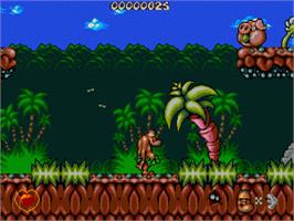 In game image of Chuck Rock on the Sega Genesis.