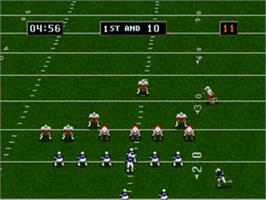 In game image of College Football's National Championship II on the Sega Genesis.