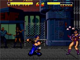 In game image of Double Dragon V: The Shadow Falls on the Sega Genesis.