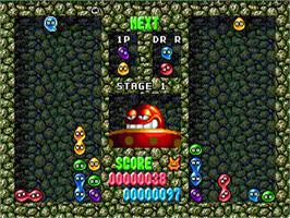 In game image of Dr. Robotnik's Mean Bean Machine on the Sega Genesis.