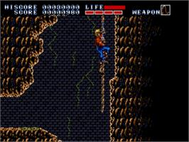 In game image of Earnest Evans on the Sega Genesis.