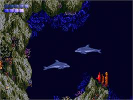 In game image of Ecco the Dolphin on the Sega Genesis.