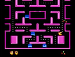 In game image of Ms. Pac-Man on the Sega Genesis.