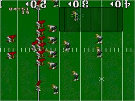 In game image of NCAA Football on the Sega Genesis.