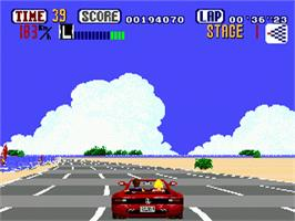 In game image of Out Run on the Sega Genesis.