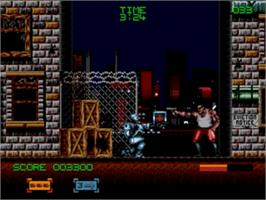 In game image of Robocop 3 on the Sega Genesis.