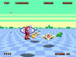 In game image of Space Harrier II on the Sega Genesis.