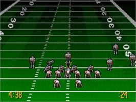 In game image of Troy Aikman NFL Football on the Sega Genesis.