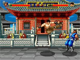 In game image of World Heroes on the Sega Genesis.