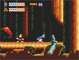 In game image of World of Illusion starring Mickey Mouse and Donald Duck on the Sega Genesis.