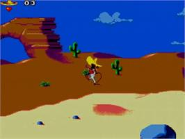 In game image of Cheese Cat-Astrophe starring Speedy Gonzales on the Sega Master System.