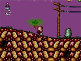In game image of Chuck Rock 2: Son of Chuck on the Sega Master System.