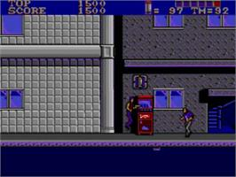 In game image of E-SWAT: City Under Siege on the Sega Master System.