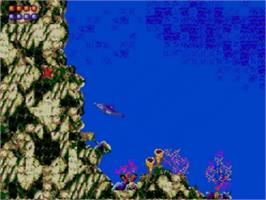 In game image of Ecco the Dolphin on the Sega Master System.